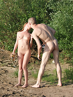 Couple kissing in water at the nude beach