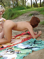 Lesbians fuck with a banana at the nude beach
